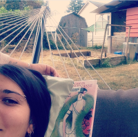 Yurt Sitting. Reading a library book in a hammock. Life is hard.